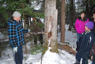 Elder/Cultural Advisor Herman Sutherland educates students about setting traps at  Kee Tas Kee Now Tribal Council (KTC) – NSD61 Winter Camp in February 2015.